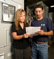 Juan Cruz and Kim Wagner get a low voltage power circuit breaker ready