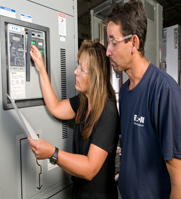 Juan Cruz and Kim Wagner get a low voltage power circuit breaker