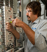 Scott Riggio works on an industrial circuit breaker
